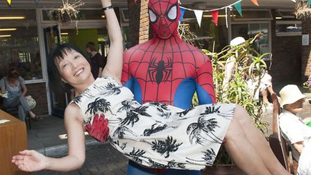 Hampstead Summer Festival organiser Cllr Linda Chung and Spider-Man at Henderson Court. Picture: Nig