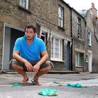 Giles Coren on Little Green Street, Kentish Town, surrounded by disguarded bags of dog poo. Picture: