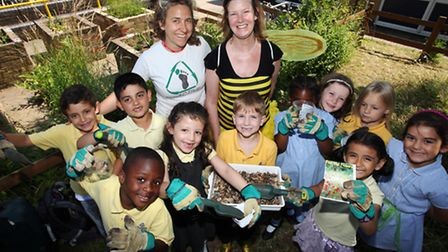 Erika Seberini of Ecoactive,left, and teacher Amanda Williams with children of Jubilee Primary Schoo