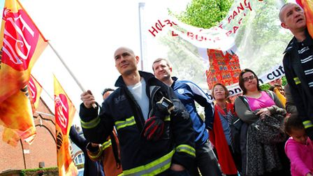 West Hampstead firefighter Sam Lee at the front of the march to save Belsize fire station. Picture: