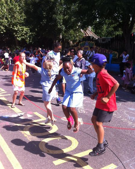 Youngsters skipping outside Randall Cremer school