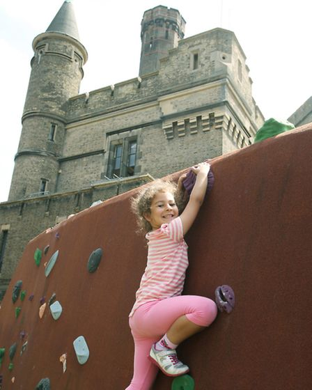 Zeina Alkhliry, six, tries some climbing at the community party by The Castle Climbing Centre.