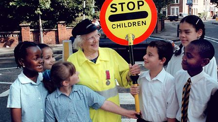 Bridie Dillon, the oldest recorded lollipop lady, pictured in 2000. Picture: Nigel Sutton