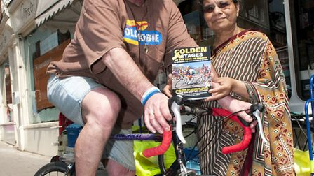 Cycling agent and writer Richard Allchin pictured with Neela Malviya of Village Newsagents, one of