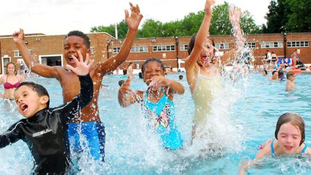 Children cooling off at Parliament Hill Lido. Picture: Polly Hancock