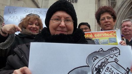 Maria Nash and supporters outside the Royal Courts of Justice ahead of her original judicial review