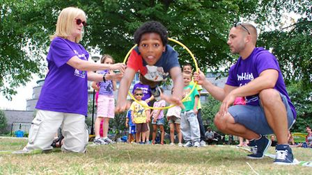 Organisers Janet Pedder and Paul Williams hold the hoop for Kareem aged 10. Picture: Polly Hancock