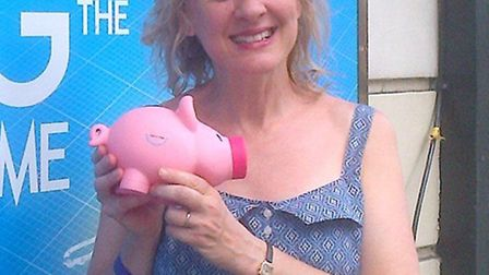 Niamh Cusack posing with a Pigs4Kids piggy bank.