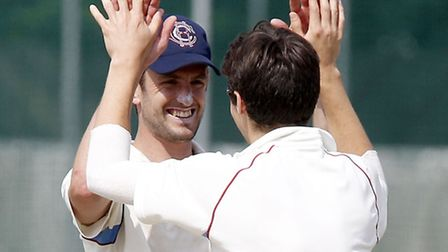 Chris Beaumont-Dark is congratulated by his captain Steve Clark (left) after capturing the wicket of
