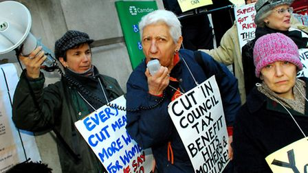 Campaigners from Camden United for Benefit Justice protest outside Camden Town Hall against cuts to