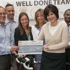 SweetTree has handed over £8,000 to charity