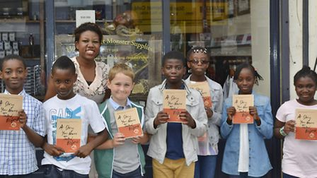 The youngsters outside the Ministry of Stories with their cookbook
