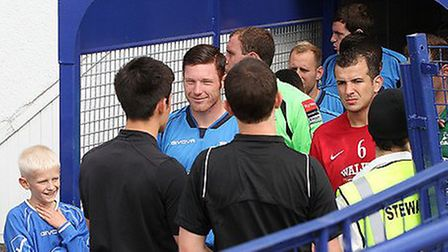 Wingate & Finchley captain Marc Weatherstone prepares to lead the Blues out of the tunnel. Pic: Mart