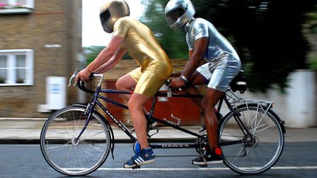 Tom Blackie (in gold) and Henri Myers leave London to cycle to Paris on their tandem. Picture: Polly