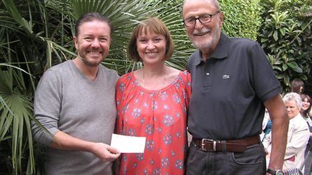 Ricky Gervais with Caroline Yates from The Mayhew Animal Home and Martin Humphery, Vice President of