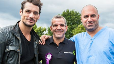 Male model David Gandy, Barry Karacostas the dog jogger and Marc the vet [Marc Abraham] at Pup Aid.