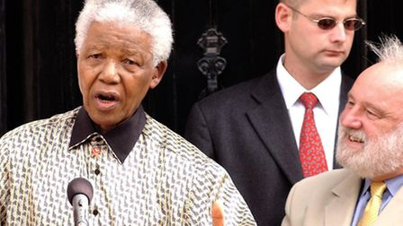 MP Frank Dobson watches Nelson Mandela pay a personal tribute to prominent anti-apartheid activists