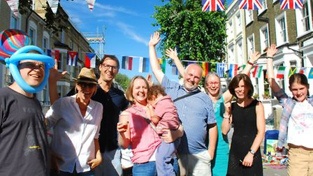 Residents welcome people to the Gayton Road Street party.