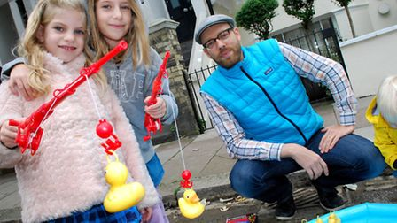 Gayton Road Street Festival 15.09.13. Pictured at the hook a duck stall sisters Abby and Taylor Sisk