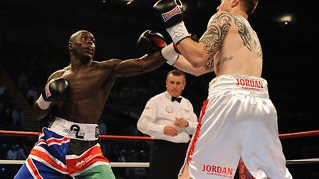 Erick Ochieng (left) in action against A.A Lowe at the Capital FM Arena, Nottingham.