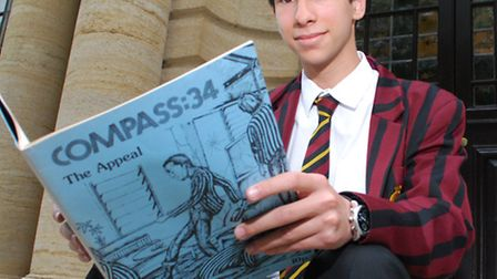 UCS student Danny Wittenberg with an old copy of Compass school magazine. Picture: Polly Hancock.