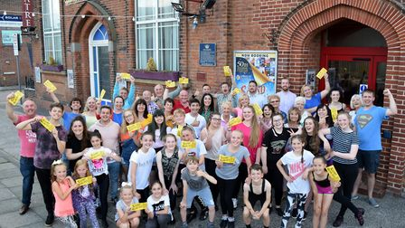 The cast of the Lowestoft Players production of 'The Sound of Musicals' holding 20 golden tickets wh