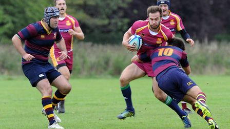Hampstead's Matt Dudgeon, who also touched down for the hosts, is tackled by HAC's Oliver Crosby.
