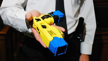 Sgt Alun Jones with a taser at Camden Town Hall. Picture: Polly Hancock