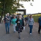 Mary Tucker conducts West Hampstead 'WHAT' 40th anniversary walk, pictured at Thameslink station. Pi