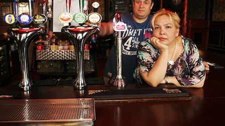 The Dolphin Pub owners Yasar Yildiz and Nuvit are upset as they are due for closure because of high