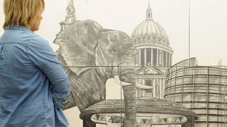 Abi Girling looks at art piece Walls Have Two Sides