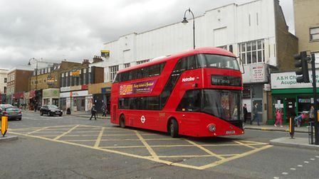 A woman has been seriously injured after falling from a Routemaster bus in Kentish Town.