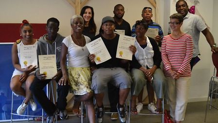 Young people hold up certificates after taking part in knife awareness training over the summer at T