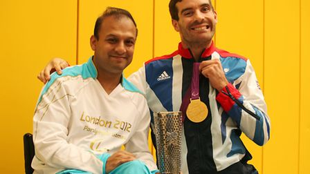 Paralympian cyclist David Stone with torch bearer Kayum Choudhury at the Big Do 2013 event at Petche