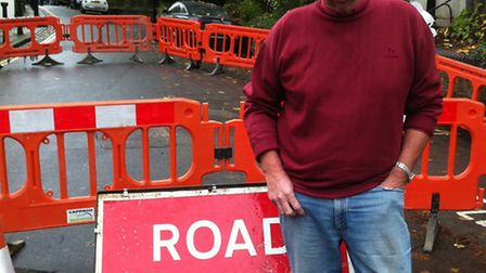 Cllr Chris Knight at the site of the leak in Flask Walk