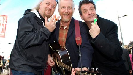 Bill Bailey, Billy Bragg and Mark Thomas busking in Camden Town. Picture: Polly Hancock