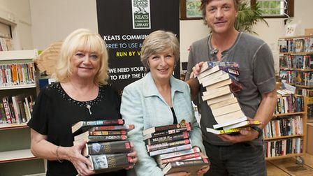 Richard and Judy, who donated 1,000 books to Keats Community Library, with Vicky Bobasch. Picture: N