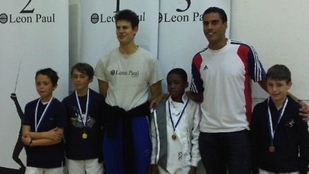 Camden Fencing Club's Under-11 boys Nathanael Alford (far left) and Jean-Baptiste Baigneres (far rig