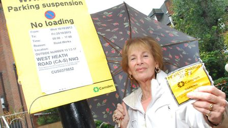 Carole Landau, who lives in West Heath Road, with the restriction notice and her parking fine