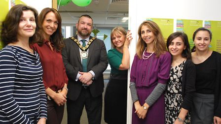 Mayor of Camden Cllr Jonathan Simpson, joins staff and volunteers with the new mezuzah at the Mitzva