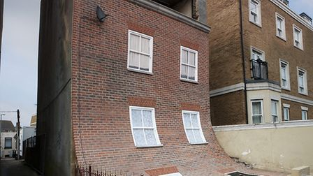 Alex Chinneck's art installation in Kent is made to appear as if the front of a house is falling dow