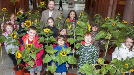 Tufnell Park School young gardeners with Ian Drummond and his gift of sunflowers after the end of hi