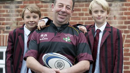 UCS Junior Branch teacher Andrew Walliker pictured with seven-year-olds Freddie Edwards & Calum Pap