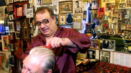 Hairdresser Peter Anthony at working on one of his last cuts. Picture: Polly Hancock