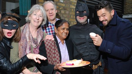 Actor Dominic Cooper tucks into the cakes at the end of the Primrose Hill treasure hunt. Picture: Po