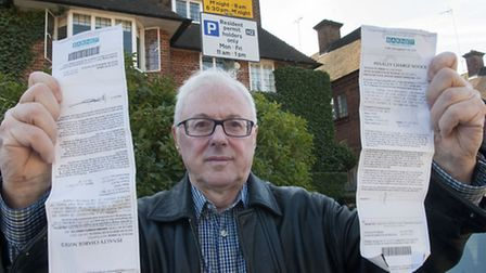 Ian Fagelson was issued with two �110 parking fines after contradictory signs were put up in Rotherw