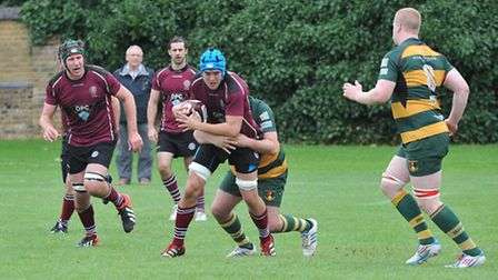 From right: UCS's Tom McAlvey (carrying ball), Tom McAviney and captain James Boyde all touched down