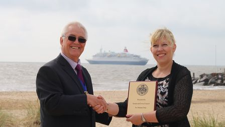 Mayor of Southwold Matthew Horwood shaking hands with Rachael Jackson from Fred Olsen Cruse Lines.