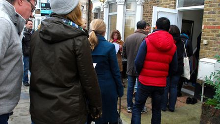 A queue forms outside the property in Sumatra Road. Picture: Polly Hancock