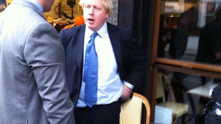 Boris Johnson speaks to Simon Marcus outside the Wet Fish Cafe in West Hampstead.